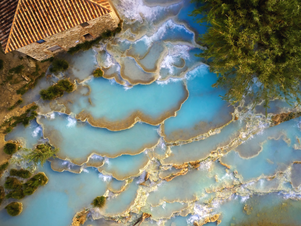 saturnia hot spring in tuscany as seen from above, one of the best things to do in tuscany italy