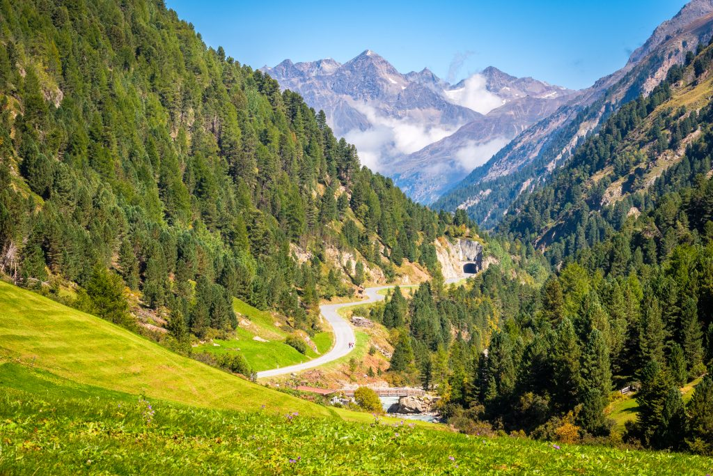 view of the mountains and curving road near vent austria, an offbeat europe destination