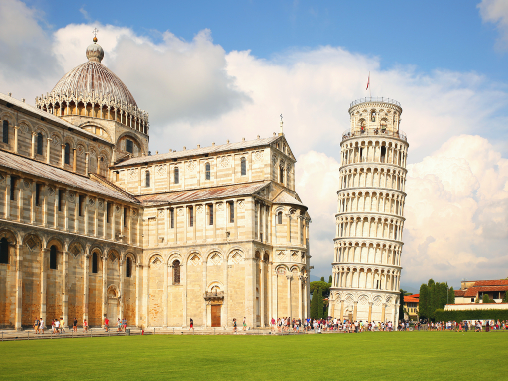 leaning tower of pisa italy with baptistery visible to the left