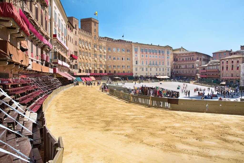 piazza del campo in siena being prepared for palio di siena with horse track laid out