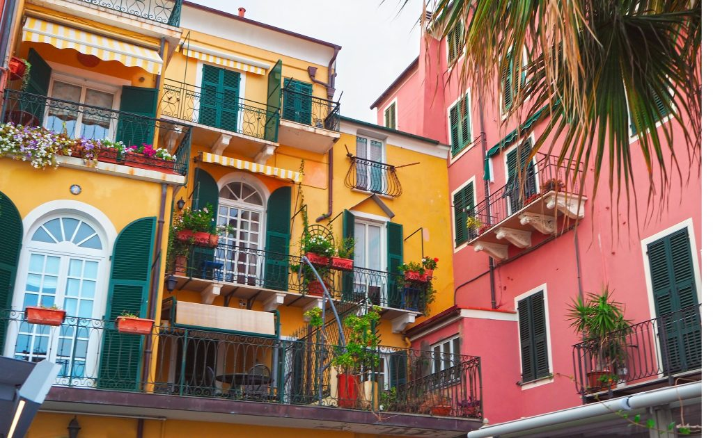 colorful yellow and pink buildings along italian riviera
