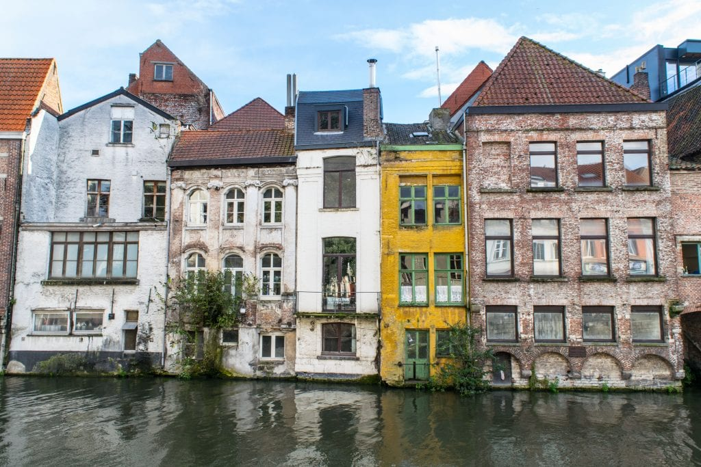 canal lined with narrow buildings in ghent