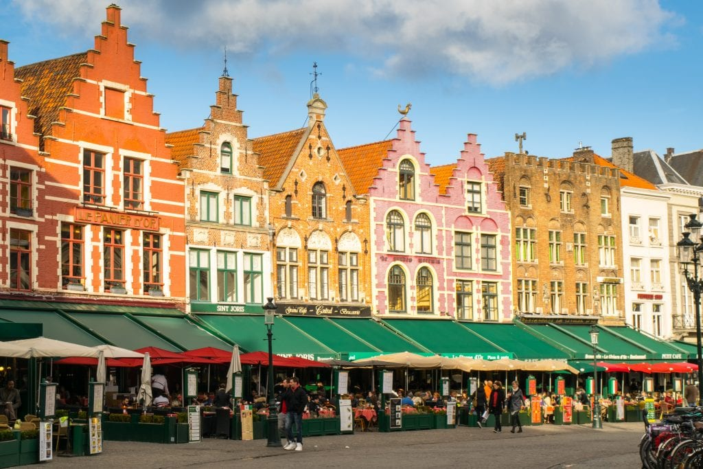colorful building on the main square in bruges, a popular reason to visit bruges vs ghent