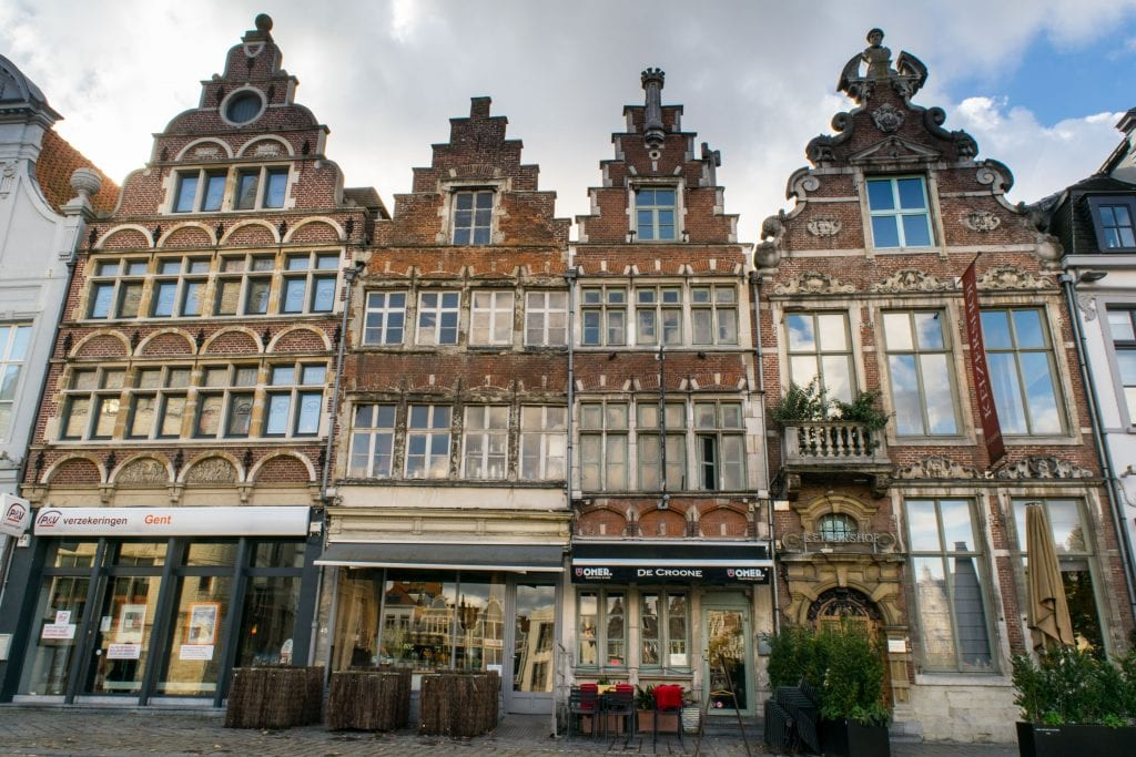 flanders style buildings in a square in ghent, architecture like this is common in either bruges or ghent