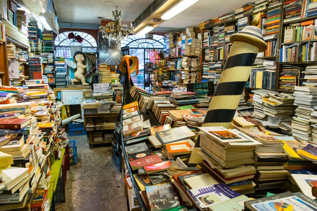 Libreria Acqua Alta in Venice with gondola of full of books to the right