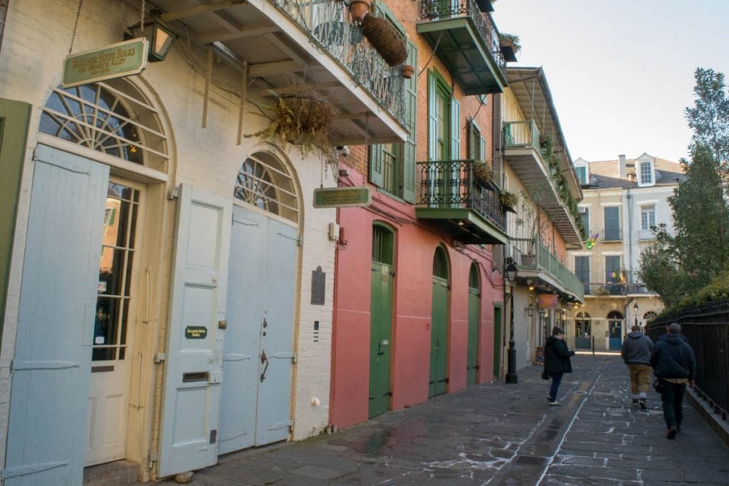 Pirate Alley in New Orleans Louisiana with buildings on the left side of the photo--be sure to check out this spot during your 3 days in New Orleans