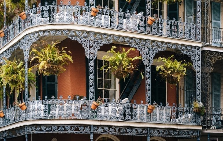 close up shot of wrought iron balconies in the french quater of New Orleans--you'll see plenty of beautiful corners like this throughout your 3 days in New Orleans itinerary!