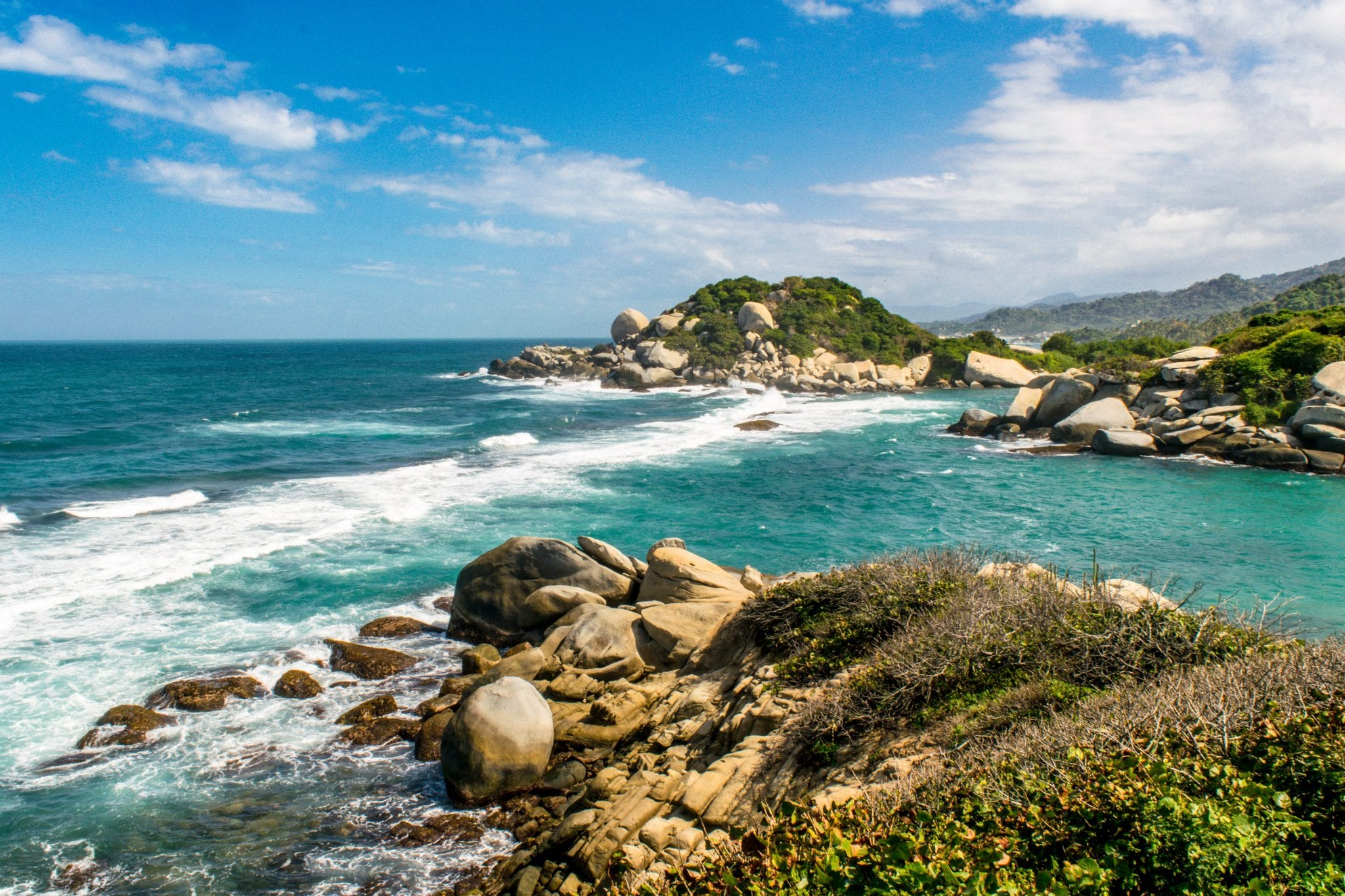 view of the water in tayrona national park colombia, as seen when living out of a backpack