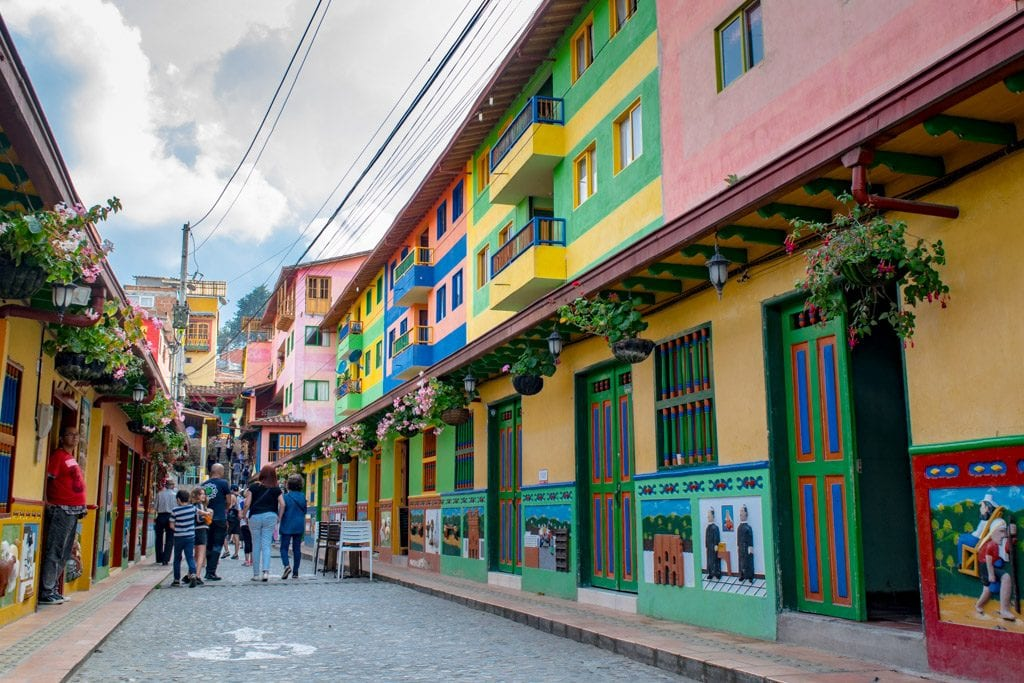 colorful street in guatape colombia -- our airbnb tips for guests can make places like this more accessible