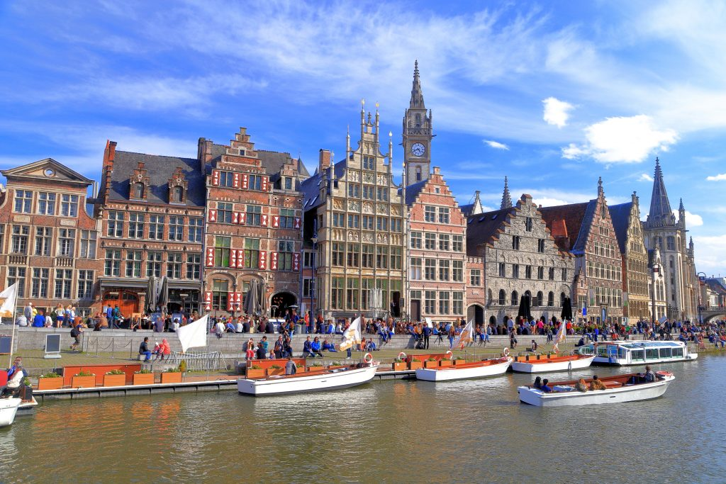 historic buildings in ghent belgium with canal cruises in the foreground