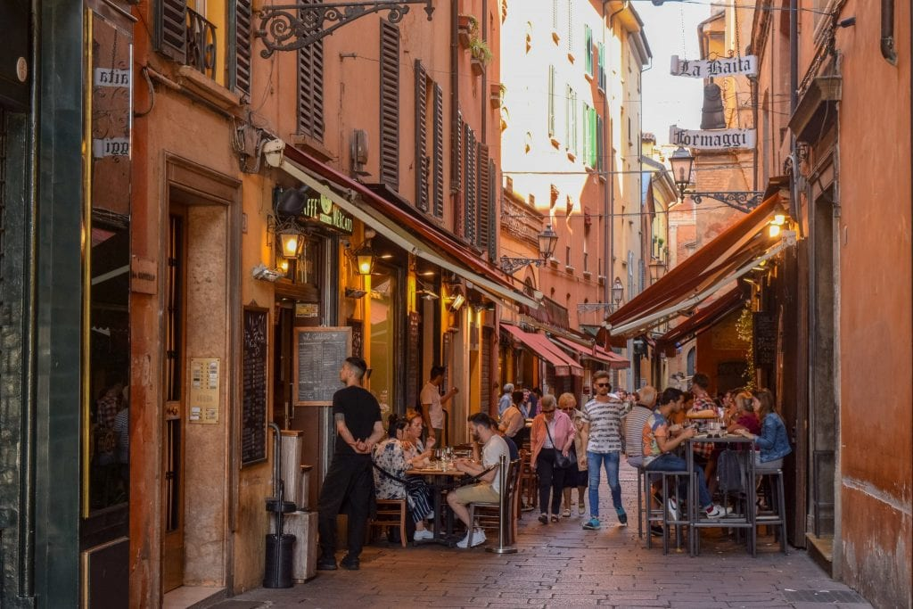 Crowded street in Bologna with outdoor restaurant, Florence to Bologna Train