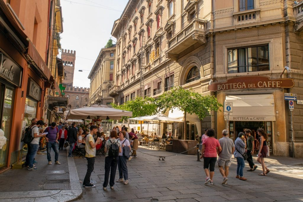 People wandering through street in Bologna, Florence to Bologna Train