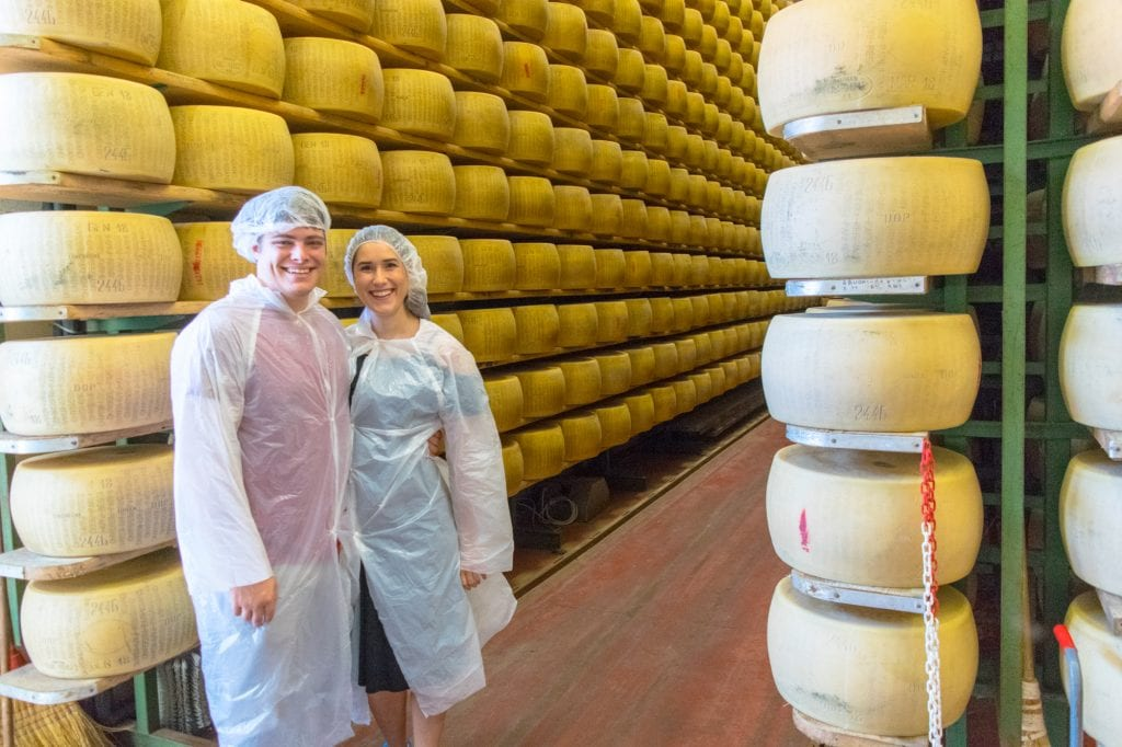 kate storm and jeremy storm touring a parmigiano reggiano factory in parma italy