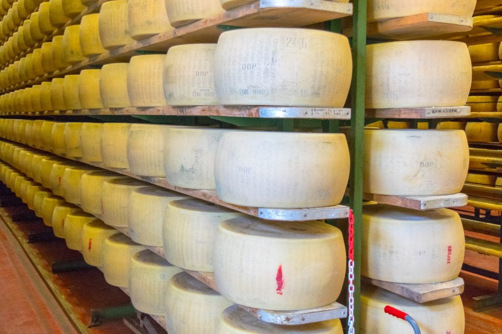 Best Things to Do in Bologna: Wheels of Parmigiano-Reggiano