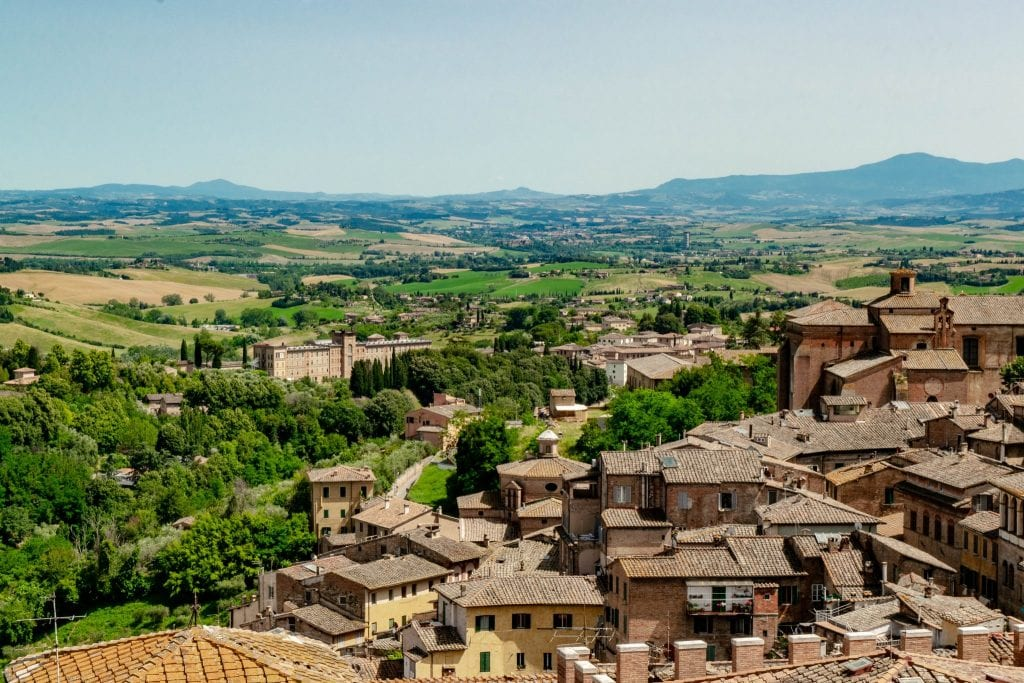 rooftops of siena italy with the countryside beyond. siena belongs on any tuscany bucket list
