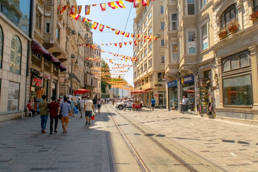 view of istanbul istiklal street with red and yellow flags hanging over it