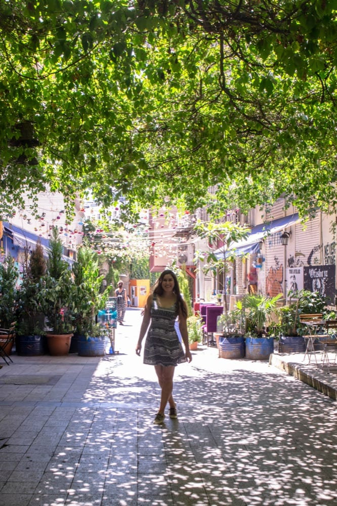 kate storm on a side street in istanbul turkey with a green canopy over it