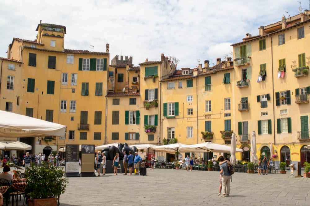 Part of the oval square in Lucca Italy, one of the essential stops on your Tuscany road trip itinerary