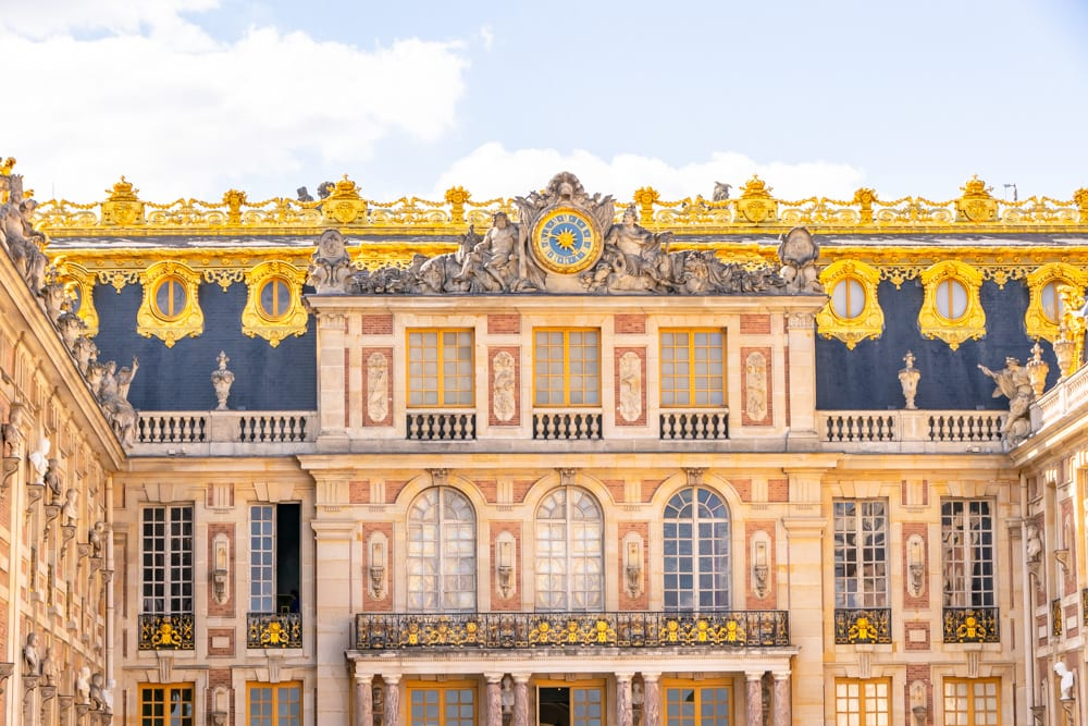 front facade of palace of versailles, a paris bucket list sightseeing destination