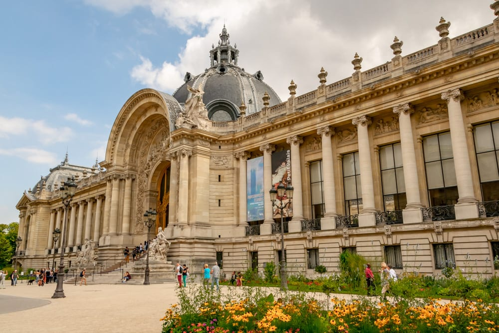 Photo of Petit Palais in Paris in August, with blooming flowers in the righthand corner.