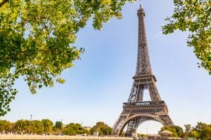 Eiffel Tower in Paris France as framed by trees