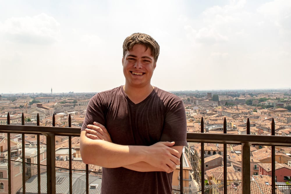 Man on top of tower in Verona: Packing list for Europe Summer