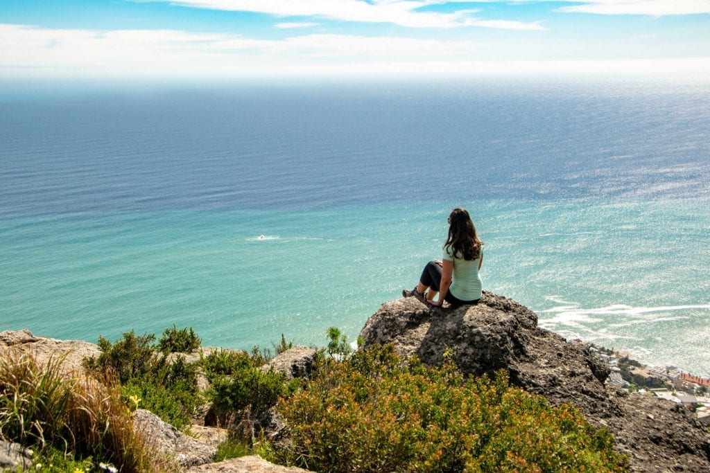 2 Week Cape Town Itinerary: Girl Hiking Lions Head
