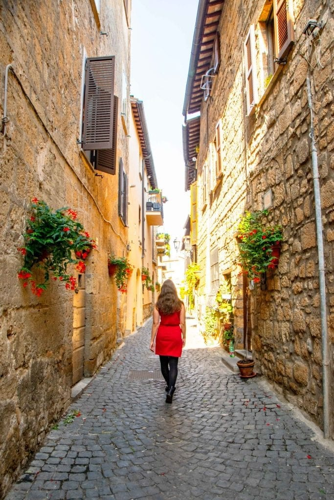 kate storm wandering a small side street in italy budget guide