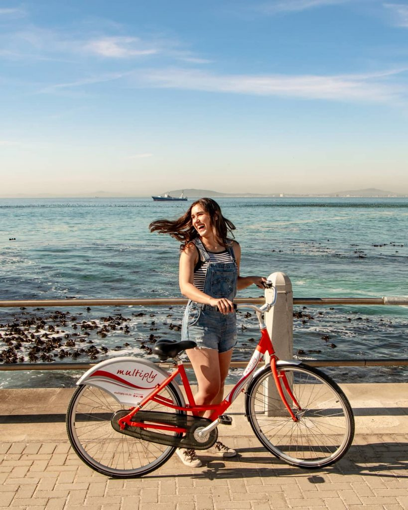 kate storm with a red bike at sea point cape town