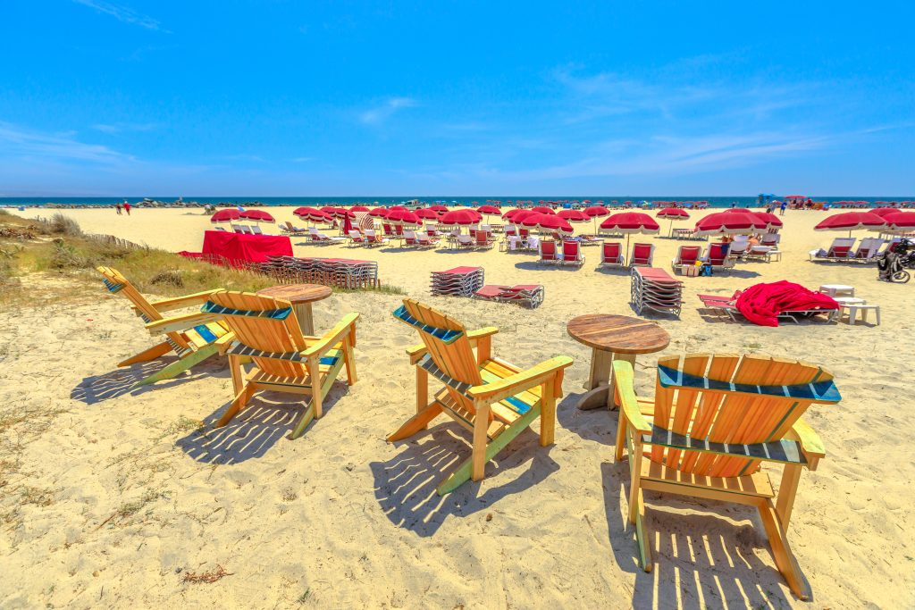 red and yellow chairs spread out on the coronado island beach