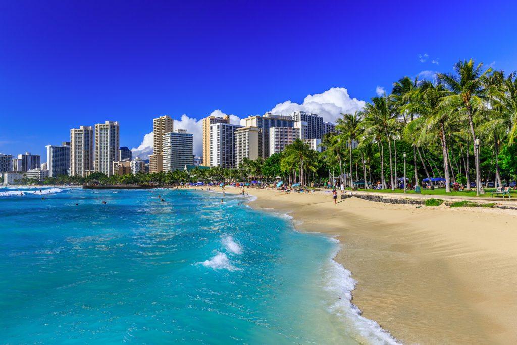 waikiki beach in honolulu hawaii with skyline in the background