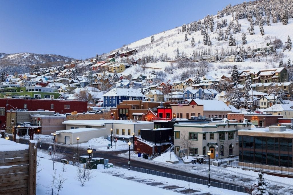 Park City Utah old town from above shot in winter, with snow covering the town. This is the perfect winter romantic getaway in USA