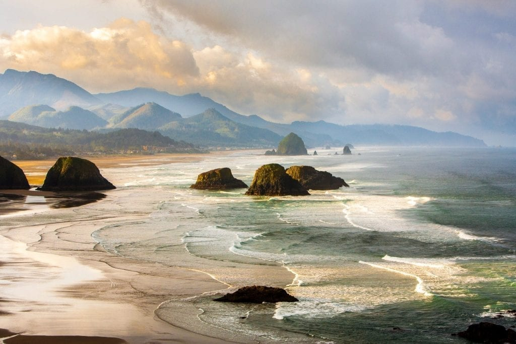 Oregon Coast at sunset looking toward Haystack Rock, one of the prettiest places in Oregon