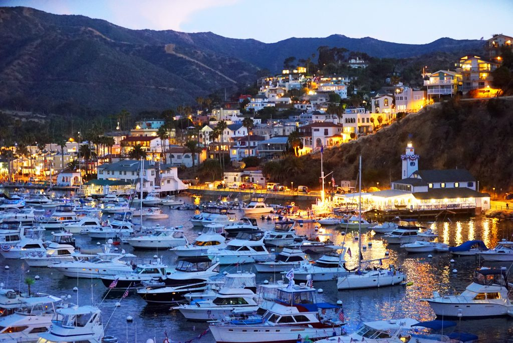 sunset at avalon harbor in catalina island california, one of the best places to visit in america for couples
