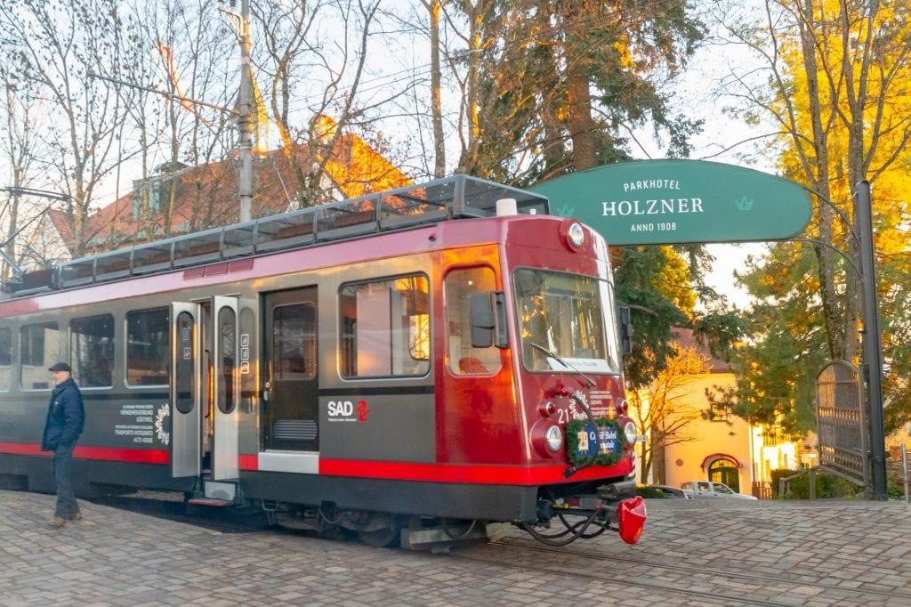 small red train in soprabolzano italy