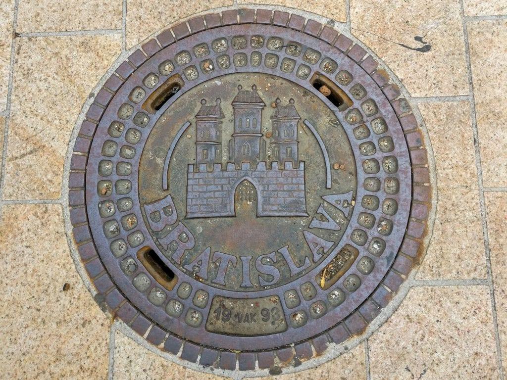 Prague Vienna Budapest Bratislava Central Europe Itinerary: Bratislava Manhole Cover with Castle