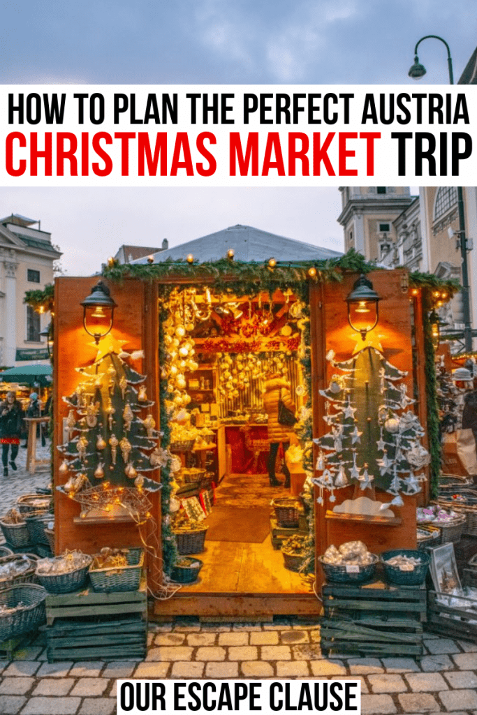 "A colorful stall with two Christmas trees taken in Vienna Austria, black and red text reads ""How to Plan the Perfect Austria Christmas Market Trip"""