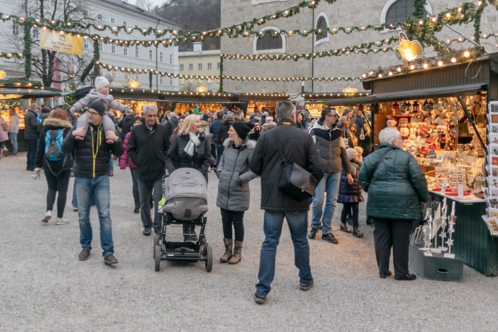 crowd of people shopping salzburg at christmas