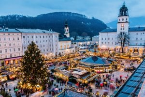 view of salzburg christmas market from above at night, one of the best things to do in salzburg in the winter