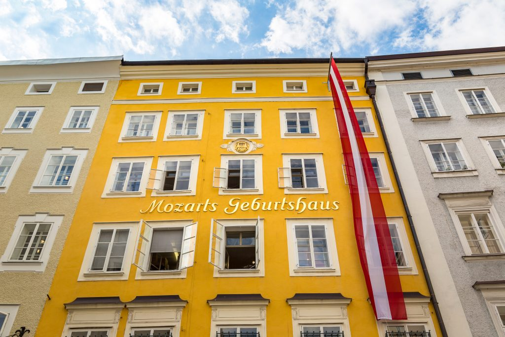 yellow front facade of mozart birthplace, one of the top attractions in salzburg austria