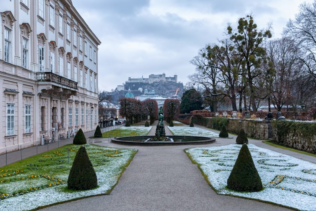 salzburg mirabell gardens in winter with a light dusting of snow