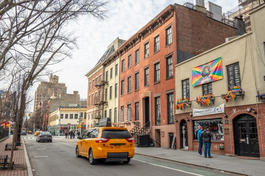New York in 4 Days: Exterior of Stonewall Inn with a Taxi