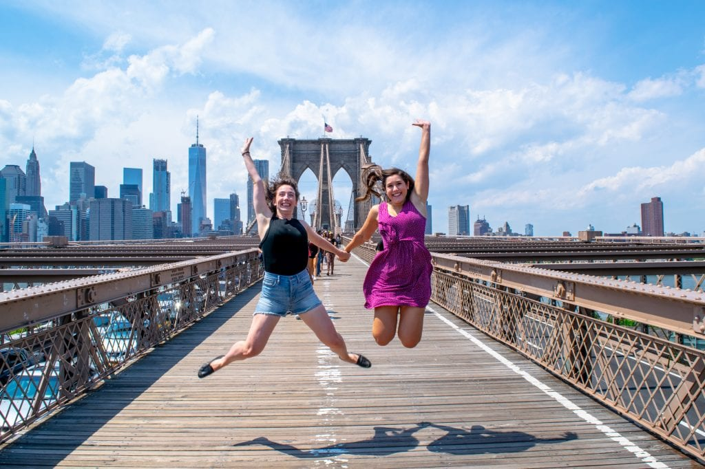 4 Days in New York Itinerary: Girls Jumping on Brooklyn Bridge