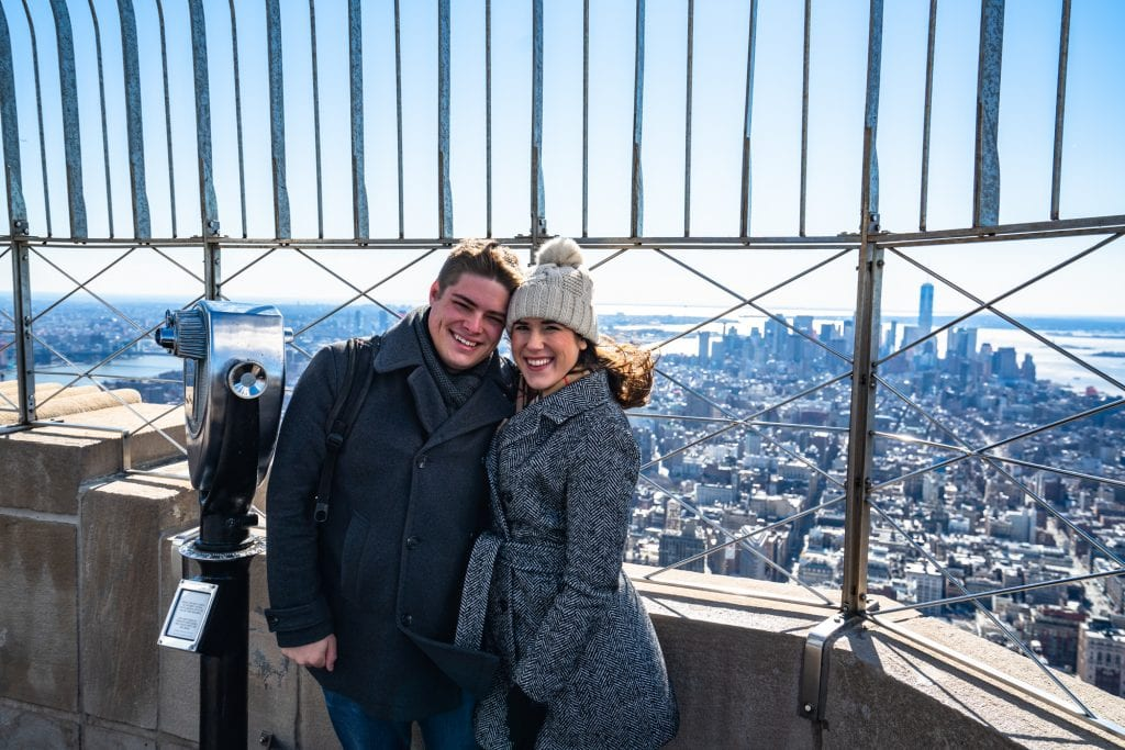 Empire State Building or Top of the Rock: Couple on top of Empire State Building