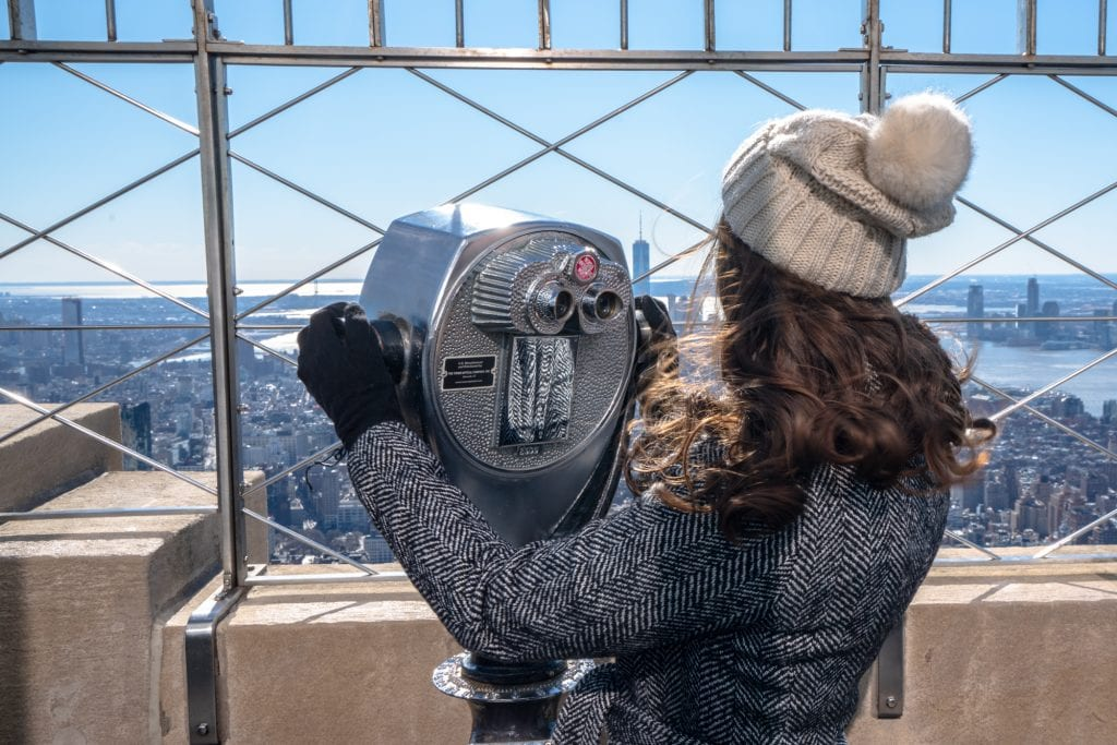 Empire State Building or Top of the Rock: Girl with Binoculars on Empire State Building