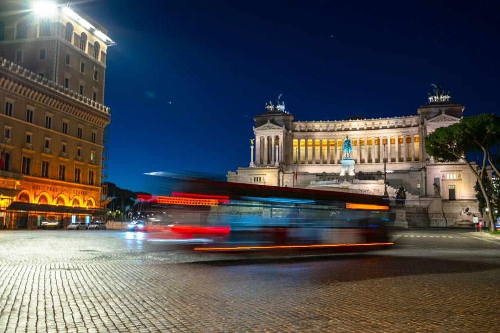 Bus in front of Altar to the Fatherland at night: What to Do in Rome at Night