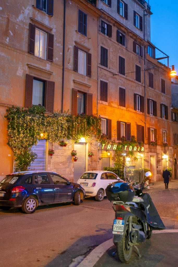 Street scene with Vespa in Rome at blue hour, What to do in Rome at night