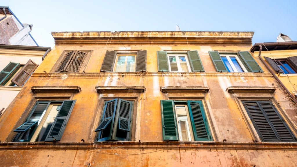 Trastevere Food Tour: Yellow Building with Green Shutters