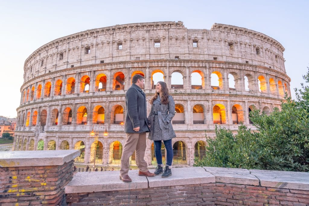 What to Wear in Rome: Couple wearing coats in front of the Colosseum