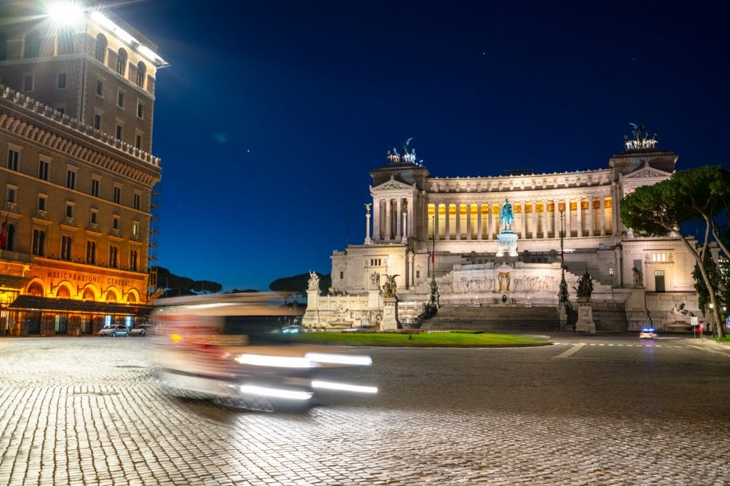 Car driving in front of Altare della Patria at night, Best Photo Spots in Rome
